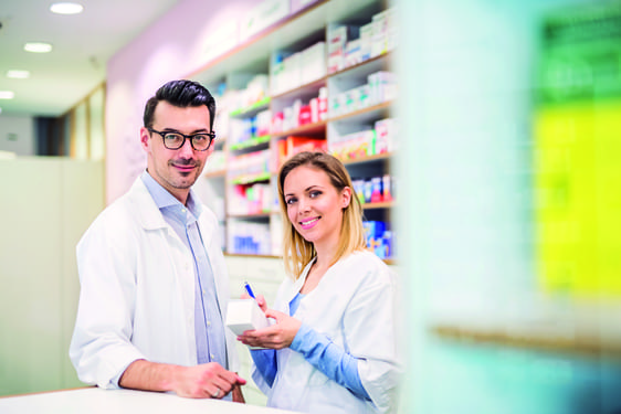 Pharmacist working in the pharmacy store using digital tablet